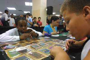 Yu-Gi-Oh! Trading Card Game fans engaged in a Yu-Gi-Oh! duel.